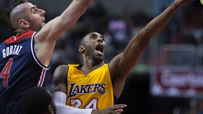 Kobe Bryant of the Los Angeles Lakers shooting against former Washington Wizards player Marcin Gortat